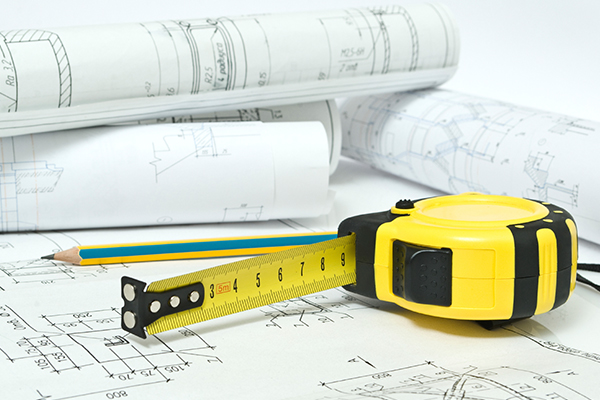 Floor plans and tape measure